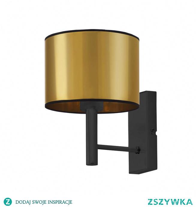 Klasyczna a zarazem zjawiskowa lampa ścienna TEGU MIRROR może zostać umieszczona w stylowym salonie, nowoczesnej sypialni a także eleganckim gabinecie domowym. Lampa składa się z lustrzanego abażura w kształcie walca, który umieszczony został na metalowym stelażu malowanym proszkowo. Takie połączenie będzie ciekawym elementem dekoracyjnym, który rozpromieni Twoje wnętrze łagodnym i przyjemnym dla oczu światłem. Lampa może służyć jako oświetlenie punktowe obrazu lub ulubionego zdjęcia a także jako dodatkowe źródło światła sprzyjające wieczornemu czytaniu w jej blasku. Oświetlenie mierzy 25 cm wysokości i 22 cm szerokości.  Kinkiet dostępny jest w dwóch odcieniach abażura: złota i miedzi, oraz w czarnym kolorze stelaża.