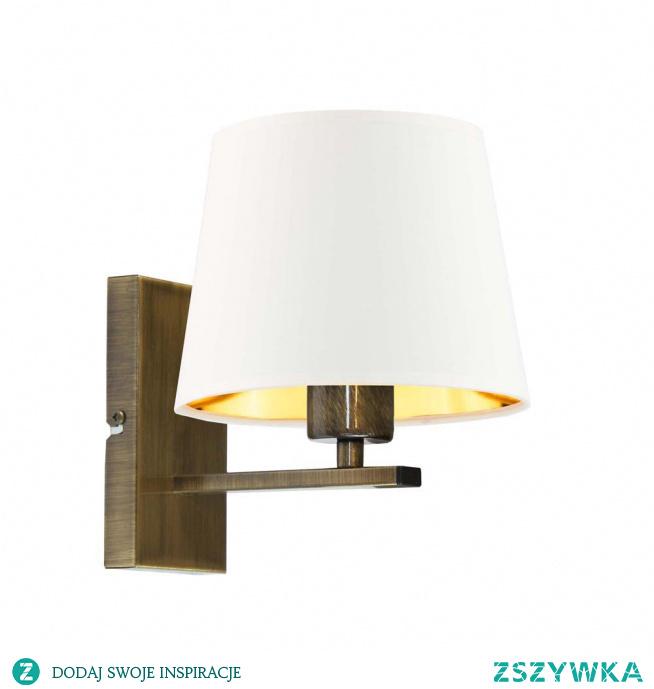 Prosta forma kinkietu HVAR GOLD idealnie sprawdzi się w klasycznie urządzonych pomieszczeniach. Stożkowy abażur stanowi w tej lampie ściennej główny element dekoracyjny. Jego środek przyozdobiony został złotą folią, która dodatkowo w białej wersji osłony lampy jest połyskująca i w wyjątkowy sposób manipuluje padającym światłem. Trzeba także przyznać, że oświetlenie to ma niezwykle kształtną postać, jego wysokość mierzy 25 cm przy szerokości równej 23 cm.  Do wyboru mamy 5 kolorów abażurów (biały ze złotym wnętrzem (złoty połysk), szary stalowy ze złotym wnętrzem (złoty mat), zieleń butelkowa ze złotym wnętrzem (złoty mat), granatowy ze złotym wnętrzem (złoty mat) oraz czarny ze złotym wnętrzem (złoty mat)) i 5 kolorów stelaży (biały, czarny, chrom, stal szczotkowana, stare złoto).