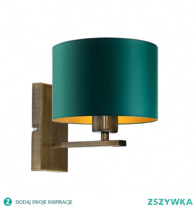 Lampa ścienna ELVORA GOLD to niezwykła forma oświetlenia, dzięki której poczujesz się w swoich czterech ścianach w sposób wyjątkowy. Zastosowany w lampie złoty środek abażuru sprawia, że emitowane przez lampę światło jest bardziej ciepłe co wpływa pozytywnie na atmosferę panującą we wnętrzu. W białym abażurze zastosowano dodatkowo połyskliwą powierzchnie złotego środka. Faktura ta odbija światło a co za tym idzie ciekawie nim manipuluje. Zastosowanie geometrycznych form w tym kinkiecie powoduje, że świetnie odnajduje się on w nowocześnie urządzonych pomieszczeniach.  Do wyboru mamy pięć kolorów abażurów (biały ze złotym wnętrzem (złoty połysk), szary stalowy ze złotym wnętrzem (złoty mat), zieleń butelkowa ze złotym wnętrzem (złoty mat), granatowy ze złotym wnętrzem (złoty mat) oraz czarny ze złotym wnętrzem (złoty mat)) oraz 5 kolorów stelaży (biały, czarny, chrom, stal szczotkowana, stare złoto).