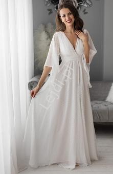 Biała sukienka ślubna w gro...