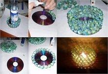 świecznik z płyty i szklanych kulek