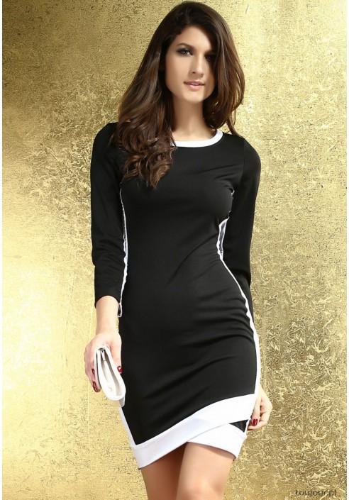 Czarna midi sukienka z białymi elementami.  Prosta i efektowna sukienka na co dzień.  Ta niecodzienna, zaskakująca sukienka wykonana została z elastycznego, rozciągliwego materiału, który doskonale układa się na każdej sylwetce. Jej prosta forma i krój pozwala na dobór dowolnych dodatków.