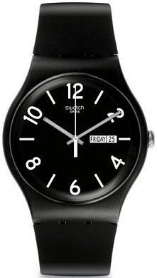 Czarny zegarek marki Swatch...