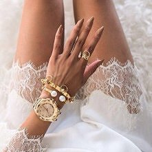 She is wearing in gold waches and gold jawellery. And this manicure, lovely &...