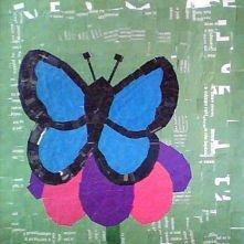 motyl wykonany z małych krateczek wycięcych z kolorowych gazet