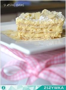 Rafaelo na krakersach: SKŁADNIKI:      2 paczki słonych krakersów np. Lajkonik 180 g      3 szklanki mleka      3 żółtka      3 czubate łyżki mąki pszennej      3 czubate łyżki ...