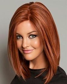 Ruda :D Śliczne ma włosy. :)