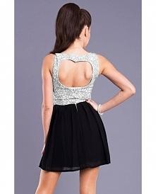Rozkloszowana sukienka z wycięciem w kształcie serca na plecach. Góra sukienk...