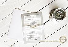 Eleganckie srebrne zaproszenia ślubne z białą kokardą. Seria Lux.  Więcej zdj...