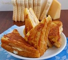 Śniadaniowy przepis na kanapki Monte Christo. Połączenie sera,szynki,jajek i ...