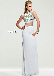 This brilliantly designed evening gown from Sherri Hill will WOW the crowd! T...