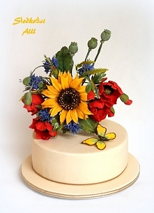 Tort ślubny z polnymi kwiatami. Kwiaty wykonałam z cukru.