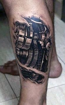 tatuaże biomechaniczne na łydce