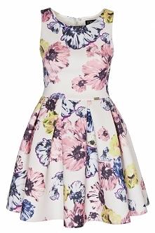 Rozkloszowana sukienka w kwiaty. Wykonana z pianki. Kliknij w zdjęcie i przejdź do sklepu