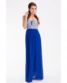 Wieczorowa sukienka maxi. Górna część sukienki pokryta błyszczącymi kamieniami. Delolt w kształcie serduszka - posiada rozcięcie z tiulową wstawką. Sukienka ma usztywniane misec...