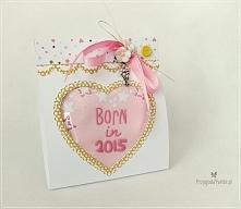 Pomysł na prezent na baby shower - śliniaczek w oryginalnym, ręcznie robionym opakowaniu.