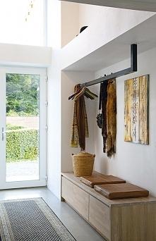 Piękny, minimalistyczny design korytarza wejściowego w nowoczesnej odsłonie c...