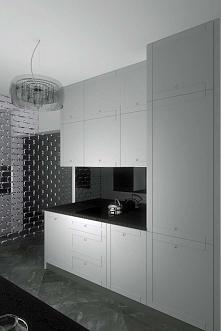 Aranżacja eleganckiej kuchni z ciekawym elementem w postaci lustrzanej ścianki.