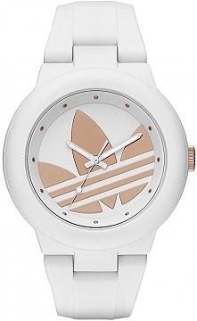 nowa odsłona zegarków Adidas. Biały zegarek damski z dużym złotym logo Adidas...