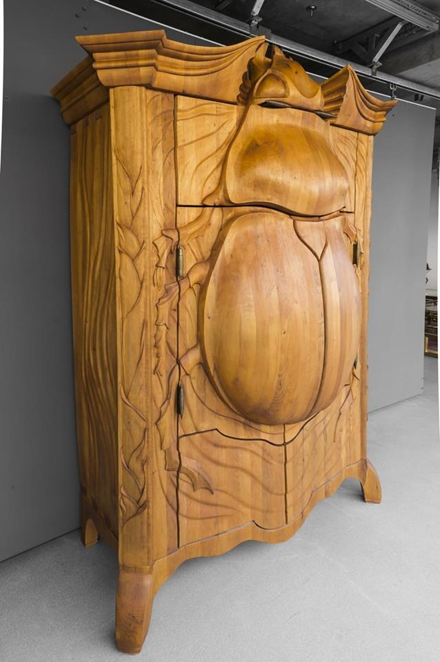 SAMSA'S ROOM  This is a wooden cabinet carved by Latvian artist Janis Straupe and his team to resemble a giant scarab beetle. Reminds Kafka's Gregor Samsa.  More pictures of this beautiful work: geekologie.com /2015/08/i-want-it-giant-scarab-beetle-carved-woo. php