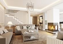 Wystrój wnętrza salonu w rezydencji pod Warszawą. Aranżacja wnętrz luksusowego, otwartego salonu, wykończonego drewnem z narożnym kominkiem.