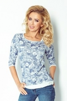 Wygodna bluza uszyta z przyjemnego w dotyku materiału - wzór kwiatowy. Bluza została przyozdobiona kieszonką oraz gustownym wiązaniem.  KLIKNIJ W ZDJĘCIE