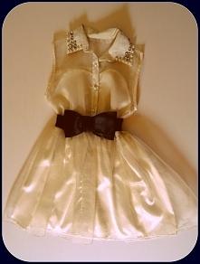 Krótka sukienka w kolorze ekri. W pasie efektowny czarny pasek - kokarda. Sprzedam. Rozmiar S/M ;)