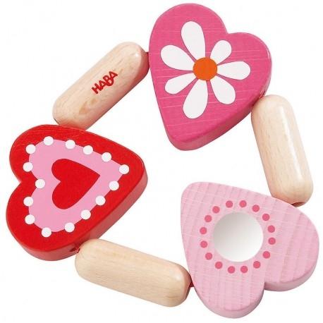 Haba 3796 - Drewniany Gryzak Mimi dla Noworodków, pomalowany bezpiecznymi farbami!  Różowe serduszka w sam raz dla dziewczynki. Rekomendowana od 6 miesiąca życia.  Wszystkie elementy umieszczono na elastycznej gumce dzięki czemu zabawka jest giętka - świetne ćwiczenie manualne dla maluszka.  Sprawdźcie sami:)
