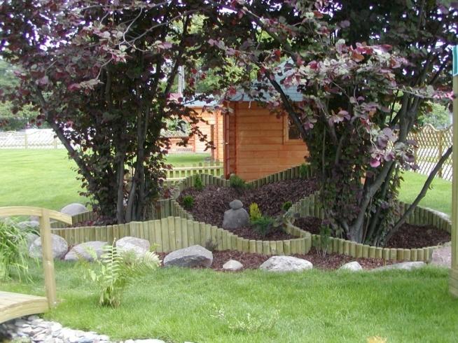 Pomysł na ogród, w którym główną rolę odgrywają  palisady