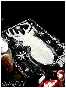 Biały jeleń na desce...