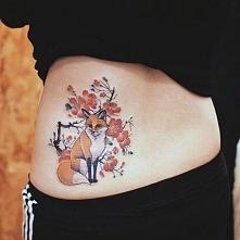 lower back tattoo fox