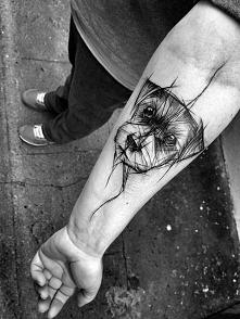 Tatuaż z wizerunkiem psiego...