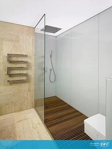 Nowoczesna, przestronna łazienka z prysznicem, spod którego nie chce się wych...