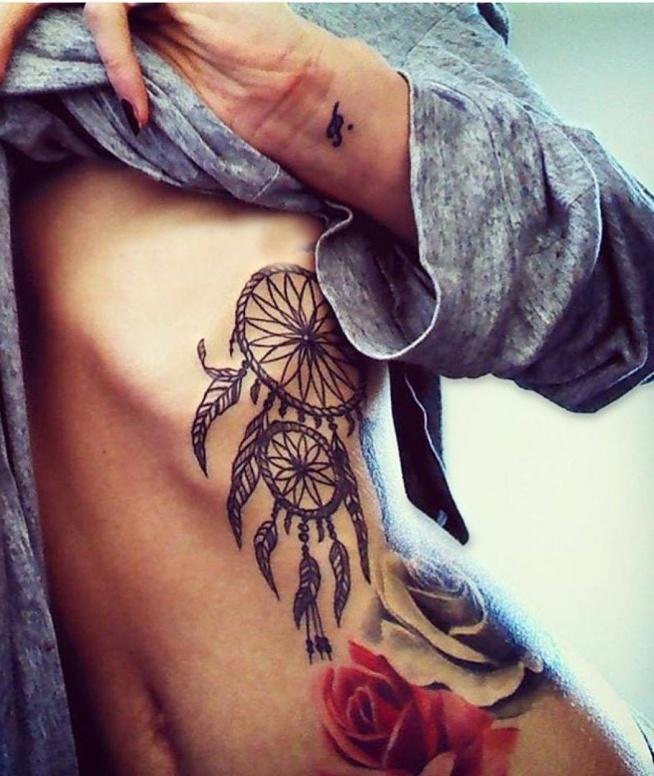 dreamcatcher on ribs tattoos