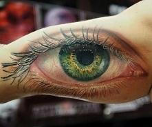 zielone oko tatuaż