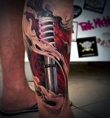 amazing biomechanical leg tattoo