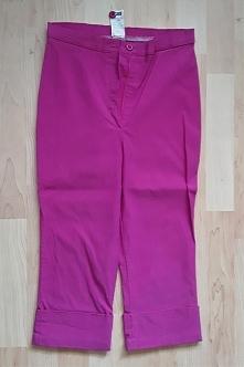 Spodnie bermudy 3/4 ORSAY rozmiar 34/36 kolor różowy, elastyczne, dopasowujące się do figury nogawka wywijana szerokość w pasie 68 cm- 80 cm długość 67 cm długość nogawki od kro...