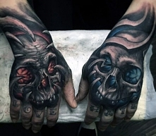 amazing skull on hand tattoo