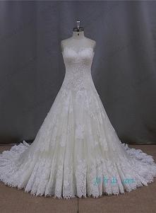 koronkowa suknia ślubna ksi...