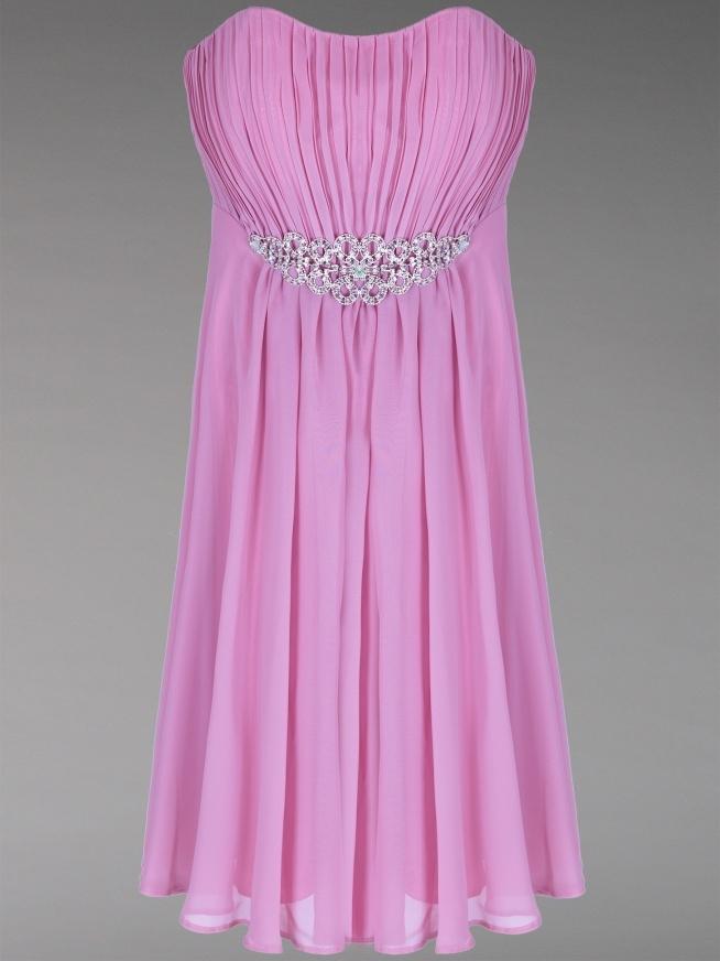 piękna sukienka z lśniącą broszką na sprzedaż