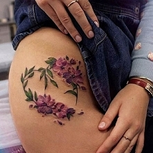 I really like flower tattoes like this...