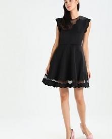 Piękna sukienka czarna rozk...