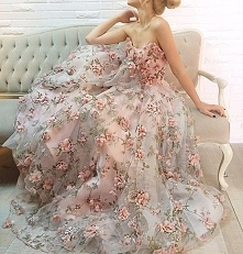 This #gown by @teutamatoshiduriqi is an absolute floral fantasy! 3D florals a...