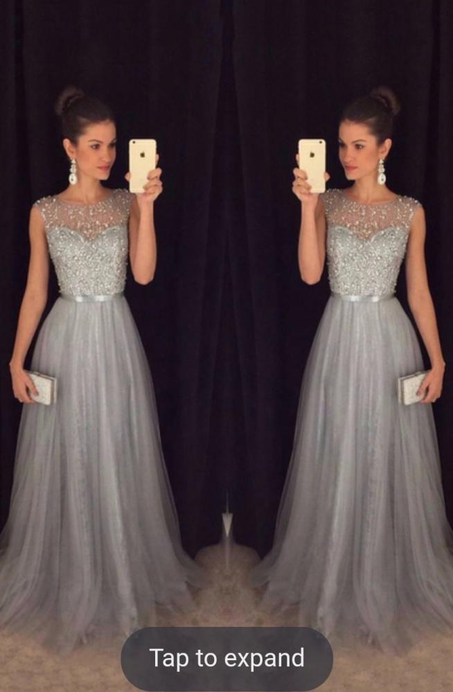 Suknia na wesele :D cudowna, srebrna... oczarowała mnie. W jakim kolorze dodatki mi doradzicie (tj. buty, torebka)?