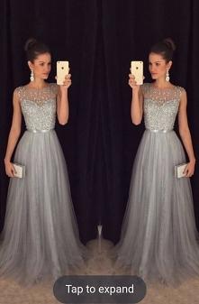 Suknia na wesele :D cudowna, srebrna... oczarowała mnie. W jakim kolorze doda...