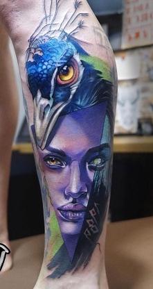 twarz i paw - tatuaże na łydce