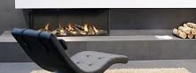 Klimatyczny ogień kominka gazowego Valentino Planika i wygodny fotel - idealny sposób na reklaks