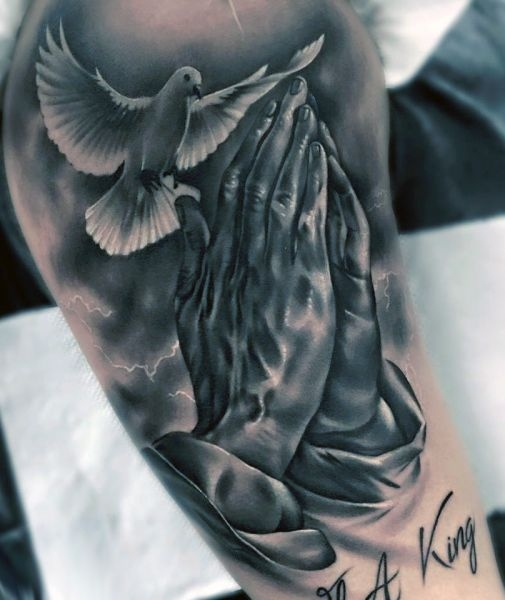 praying hands and dove tattoo
