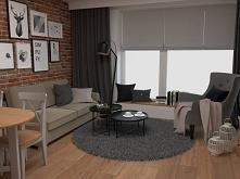 Mały salon z ceglaną ścianą...
