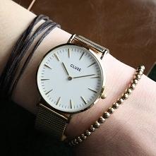 Zegarek Cluse CL18109 Gold/White to piękny model dla wszystkich fanek eleganckiego minimalizmu! Już dziś stań się szczęśliwą posiadaczką tego wspaniałego czasomierza!